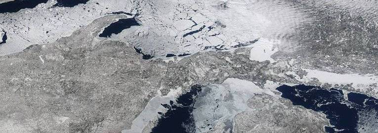 Satellite view of the great lakes, mostly frozen.