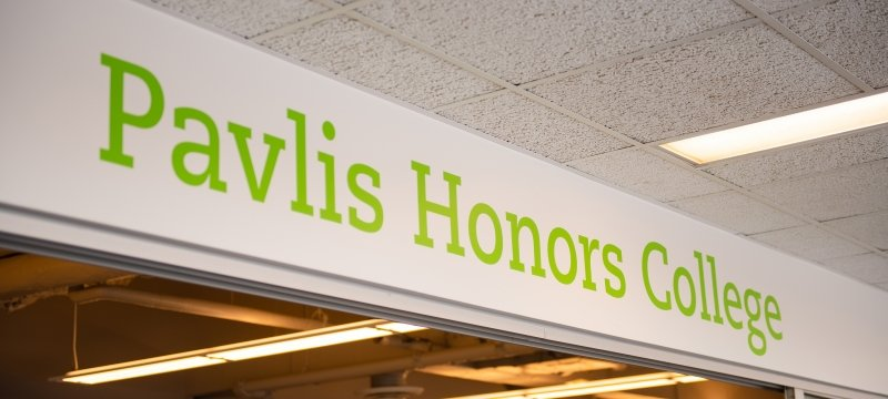 Pavlis Honors College sign
