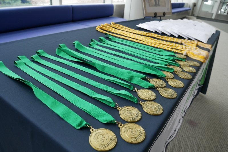 A table full of honors medallions
