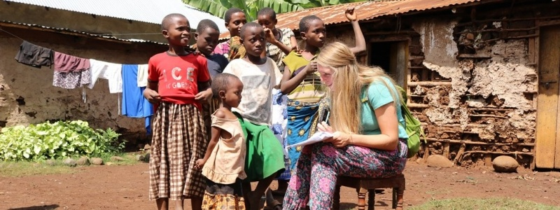 Female student working with children in Africa.