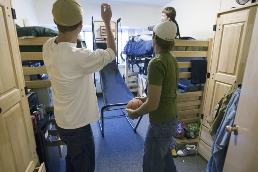 Students playing basketball in their dorm room