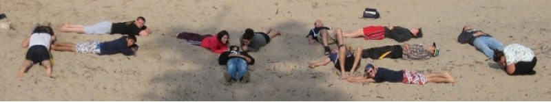 Students lying on a beach