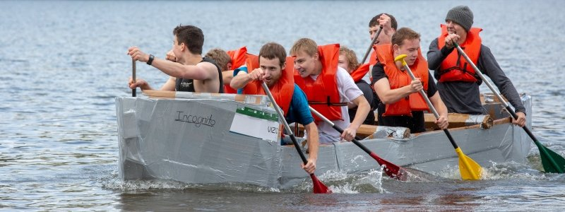 team racing in cardboard boat