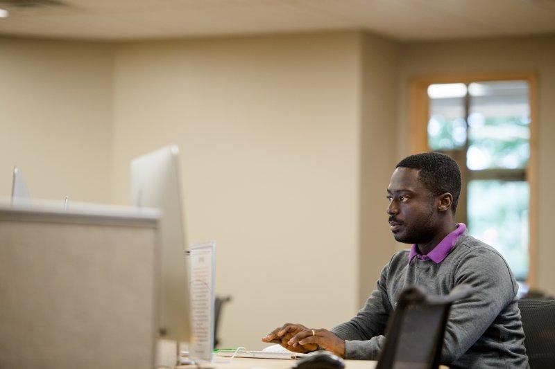 Grad student at a computer in HDMZ