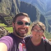 Two students posing for a selfie in the mountains of South America.