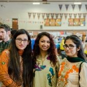 Three students pose for a picture at Parade of Nations.