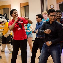 International students and staff dancing