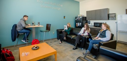 Students sitting inside the Jurva Student Lounge