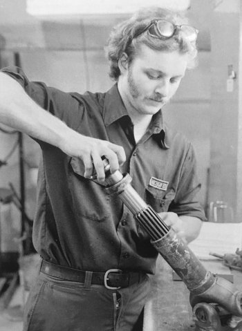 Rick working on a piece of equipment