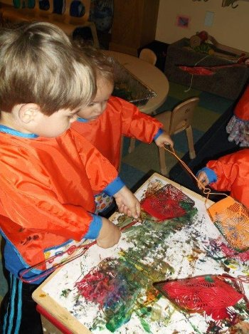 Children painting with flyswatters.