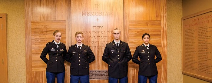 ROTC students in front of the War Memorial Wall in the Memorial Union Building.