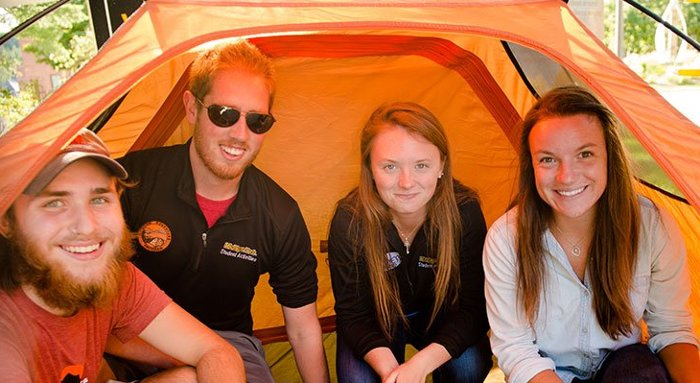 Students in a tent.