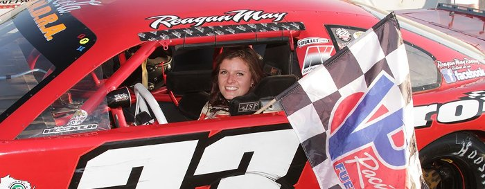 Reagan May in her #33 car with the checkered flag..