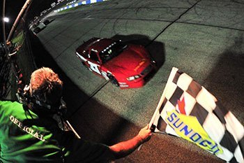 Reagan May crosses the finish line to take the checkered flag.