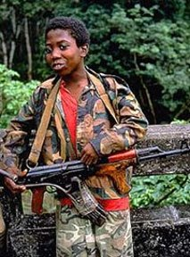 A 12 year old Liberian soldier.