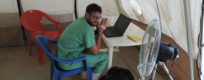 Schreiner working in his water and sanitation office.