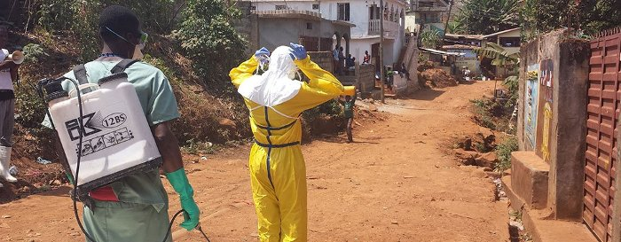 Suited up for household decontamination in Freetown, Sierra Leone.