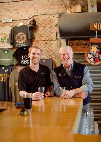 Dick Gray of Keweenaw Brewing Company and son Ryan of Electric Brewing Supply sharing a drink at the KBC.