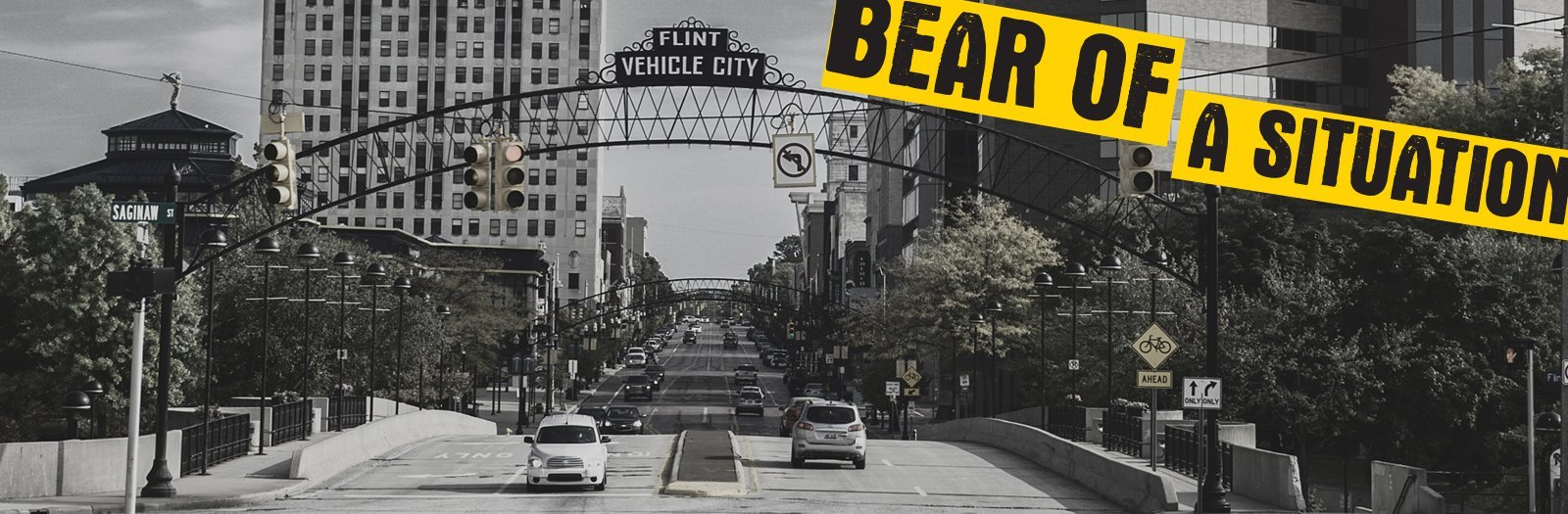 Bear of a Situation text over a view down a Flint street.