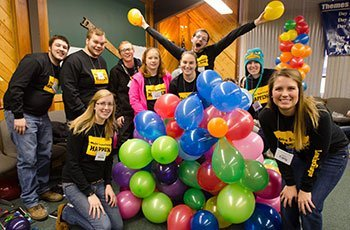 Leadershape participants with balloons.