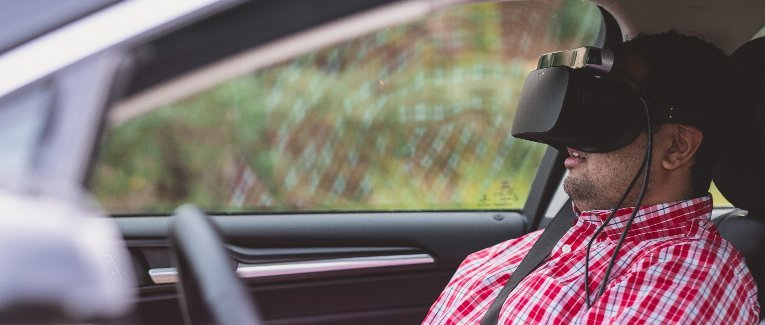Student in a car with 3-D virtual reality display.