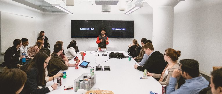 Students in a conference room learning about Twilio.