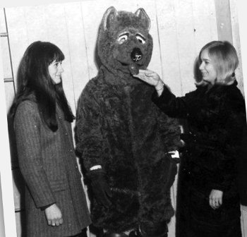 Vintage unofficial bear mascot with two female fans.