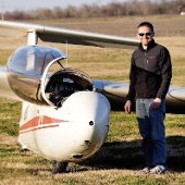 Todd Hahn next to a glider.