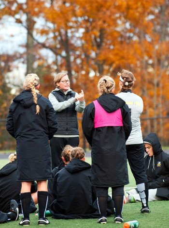 Coach Michelle Jacob speaks to MIchigan Tech's Women's Soccer Team.