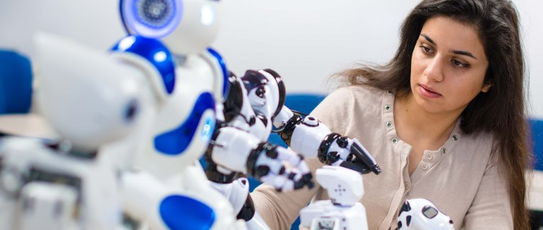 Female student working with robots.