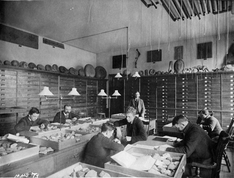 Archive photo of people working in a geological sciences lab.