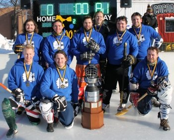 Broomball team wearing medals with the trophy.