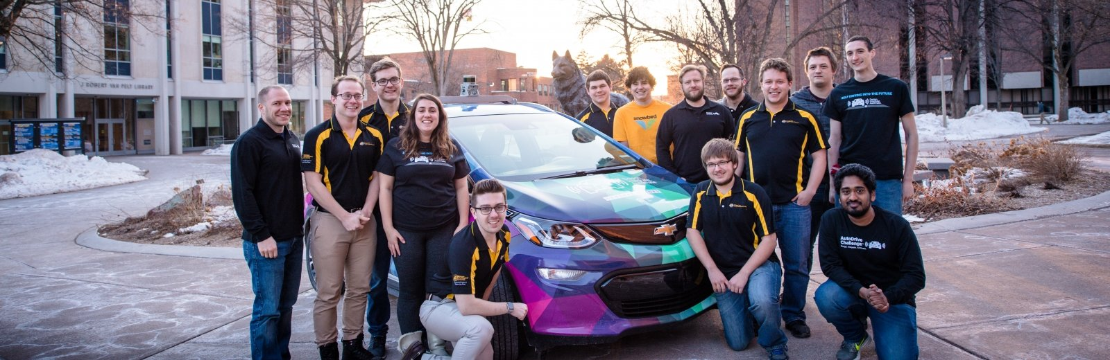 Prometheus Borealis team standing around the car on campus.