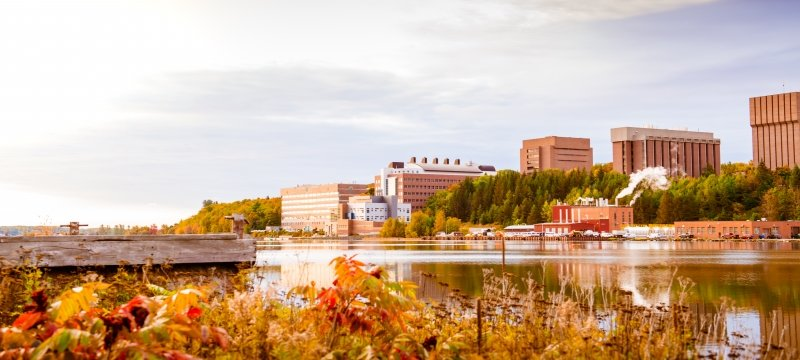 A view of campus in the fall from across the Keweenaw Waterway.