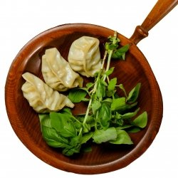 Three dumplings with a side of greens.