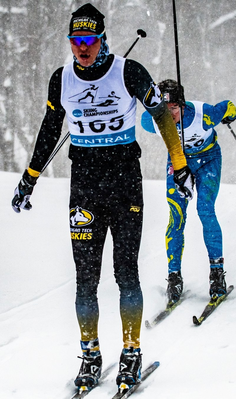 Gaspard Cuenot skiing with a competitor behind him.