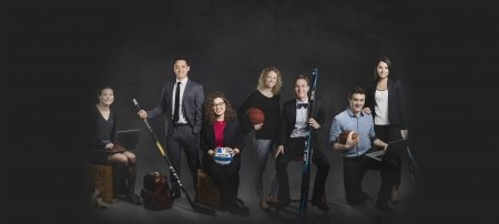 Seven athletes dressed up and holding their sports equipment.