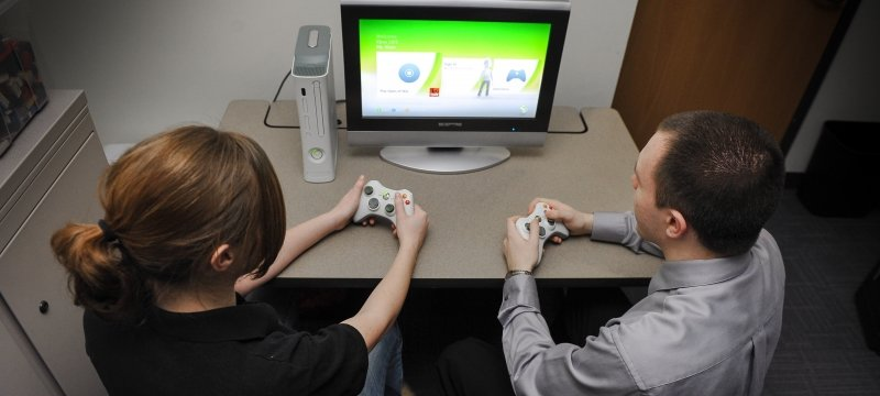 Two students playing a video game.