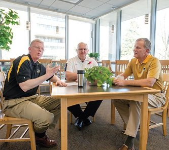 """Through this campaign, so many people have come to see Michigan Tech as a place of consequence,"" says Vice President for Advancement Shea McGrew, left, during a conversation with Tech Fund Chair George Butvilas, center, and President Glenn Mroz."