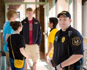 Photo of  Officer Reid DeVoge with some students