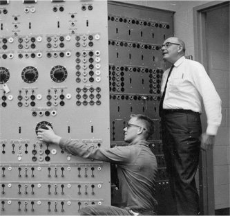 Professor William Longacre instructing a student in operating an electrical control panel