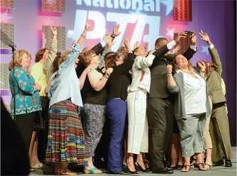On stage at the 2014 national convention, state PTA presidents from all over the United States crowd around for a selfie with Thornton.