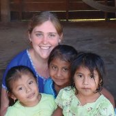 Peace Corps student with three children.