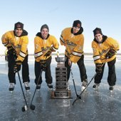Huskies hockey players on the frozen Portage Lake with the MacInnes Cup.