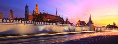 A wall and skyline in Thailand.
