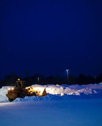 A front-end loader making room for the next storm
