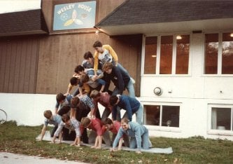 A human pyramid in front of Wesley House