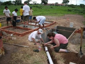 EWB team working on a septic system they designed for a school in Bolivia