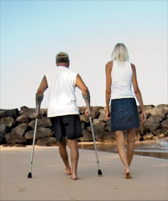 Bob and Ellen Raimo walking on beach