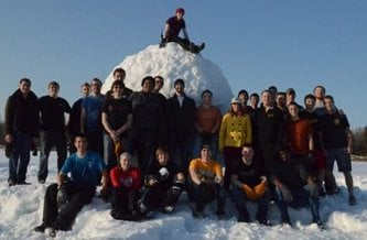 Students standing around a 32.94ft snowball.